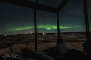 lying in bed watching the Northern Lights