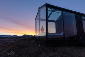 Panorama Glass Lodge with a sunset over Hekla volcano