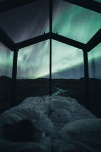 A view of the Northern Lights from the inside of the Panorama Glass Lodge