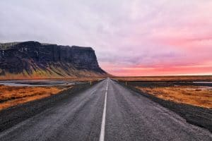 Route 1 in the south coast of Iceland during a pink sunset