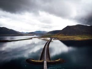 a road in leading to Iceland's westfjords directly through a fjord