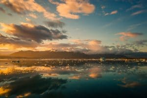 the midnight sun in Iceland reflected on the water