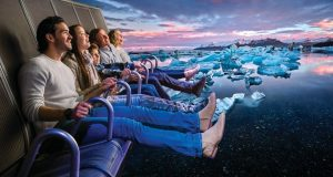 FlyOver Iceland ride advertisement with people over Jokulsarlon glacier lagoon