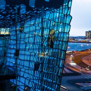 A close up of the fish scale glass of the Harpa Concert Hall in Reykjavik