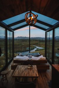 the inside of the Panorama Glass Lodge under the midnight sun