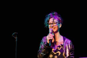 Local Comedian Kimi Taylor performing a stand-up comedy show in Reykjavik