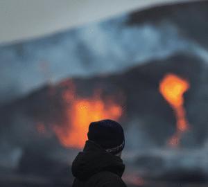 Chris Ayliffe standing in front of Geldingadalir erupting volcano in Iceland
