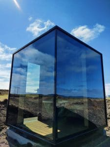 The Panorama Glass Lodge Sauna from the front